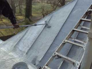 Roof Menders starts winter metal roof restoration project