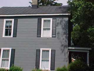 Roof, shutters and siding with white trim