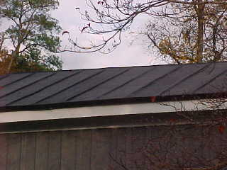Final image of roof of bungalow with tin roof color